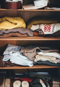 Some clothes packed on shelves.