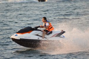 Jet-ski going fast on water.