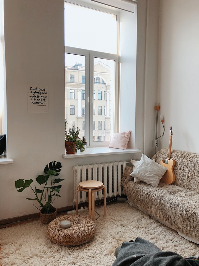 Alt. tag: A bright, cozy apartment with light-colored furniture