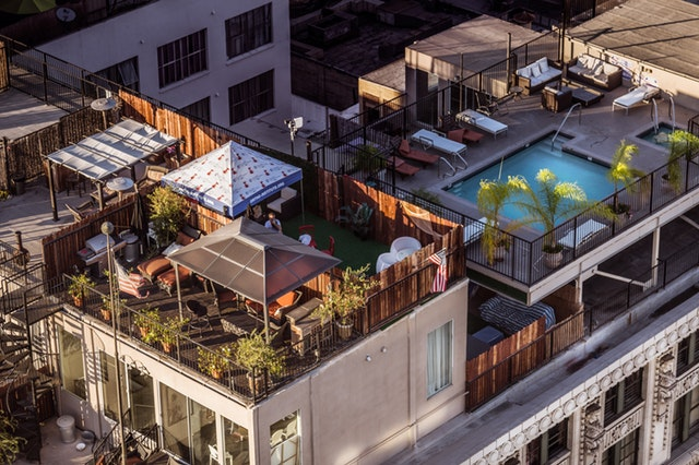Condominium and a swimming pool to illustrate the Washington Heights real estate market trends