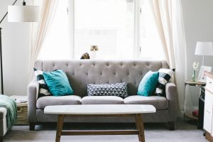 A living room furnished according to the rules of timeless interior design trends.