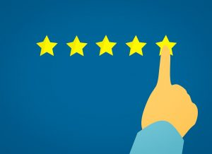 A finger pointing to the five-star customer experience as you will do once you find reliable movers in NJ area.