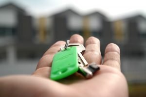 A person handing the keys.