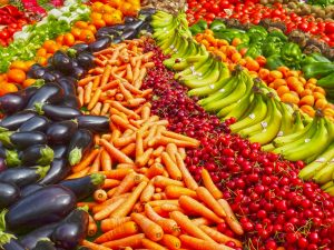 A lot of fresh fruit and vegetables at a market.
