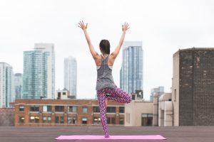 A girl doing yoga.