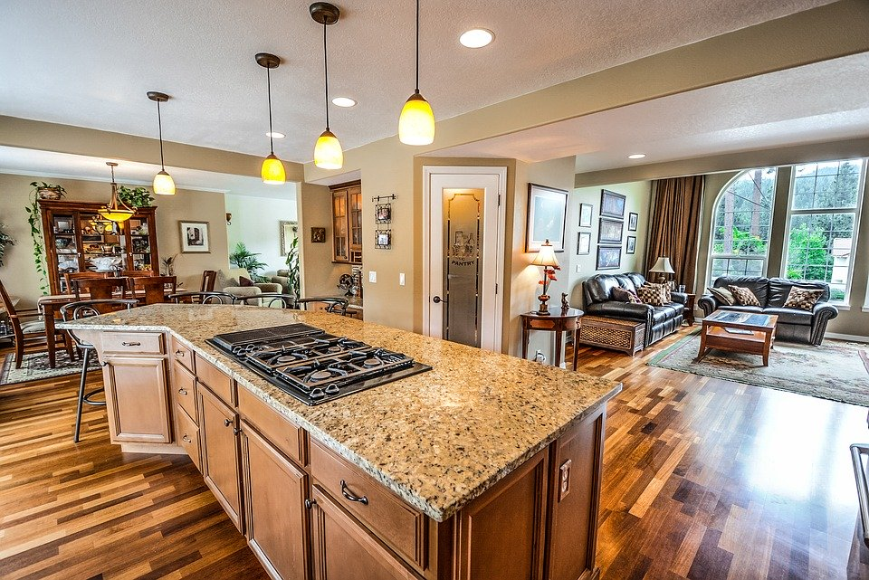 a beautiful and spacious kitchen that extends into an even larger living room.