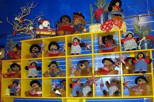 Large yellow shelves for storing kids' dolls.