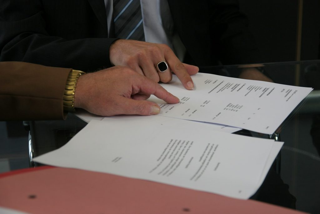 an agent and client reading the agreement