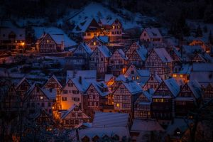 A mountainous town at night.