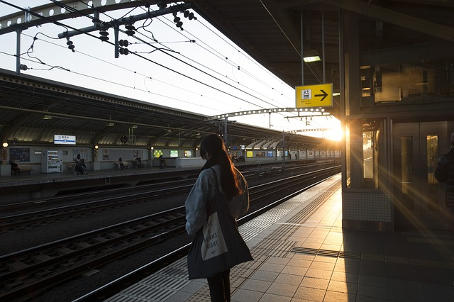 Woman on the train station thinking about secrets to finding a perfect apartment in Tokyo