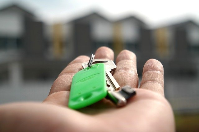 Giving keys after buying a family home in Mendham, NJ.