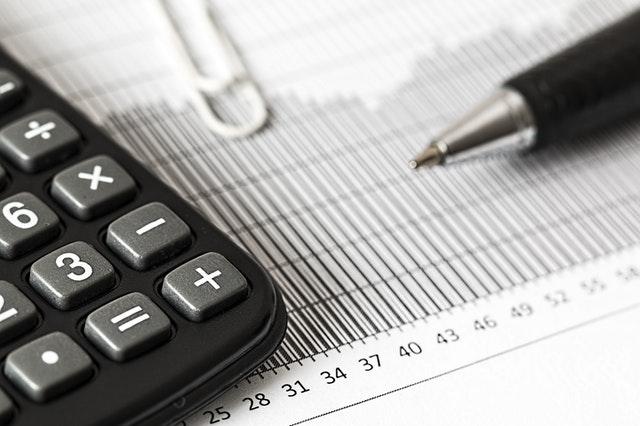 A paper, pen, and a calculator.
