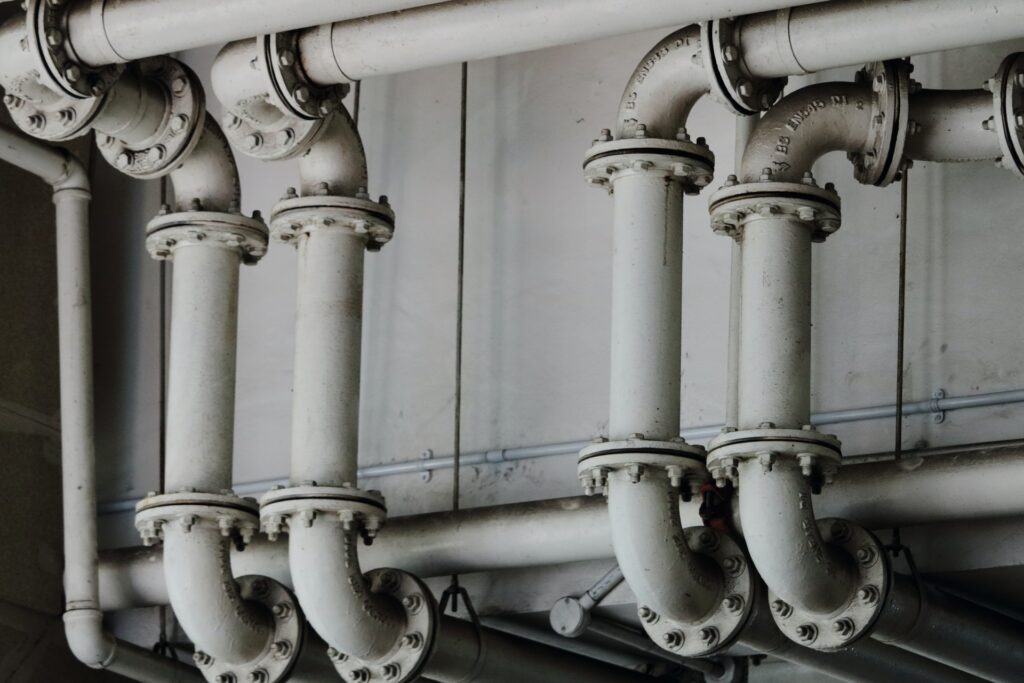 An image of white metal pipes