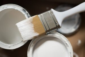 A paintbrush and paint cans.