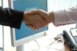 A handshake with a professional who can help you find the best ways to present your Carroll Gardens home to buyers